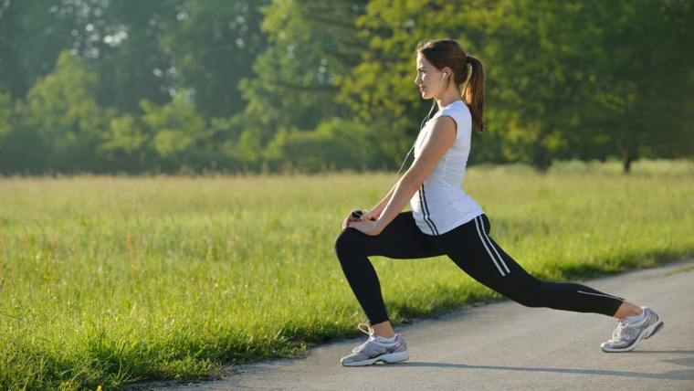 young woman stretching before Fitness and Exercise
