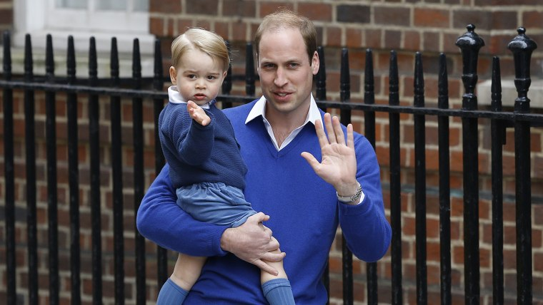 Prince George and William arrive to greet the new royal baby