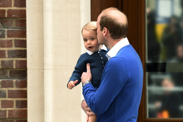 Prince William kisses Prince George outside the Lindo Wing