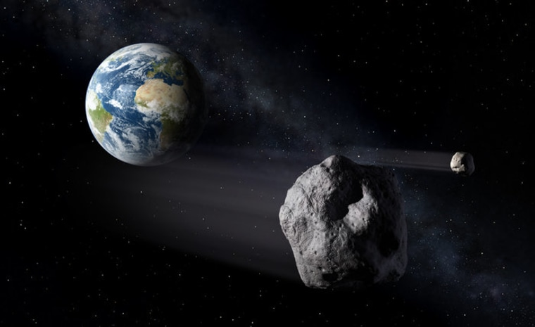 Image: Artist's concept of an asteroid flying close to Earth