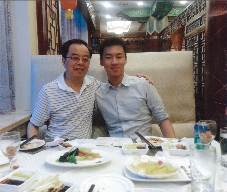 Image: Michael Deng and his father