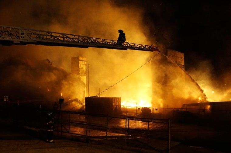 Image: Firefighters battle a blaze