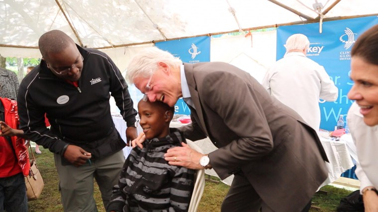 Former President Bill Clinton tours projects in Africa.
