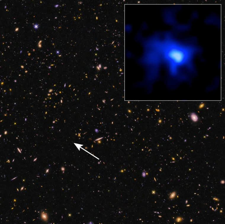 Hubble Space Telescope image of the farthest spectroscopically confirmed galaxy observed to date (inset).