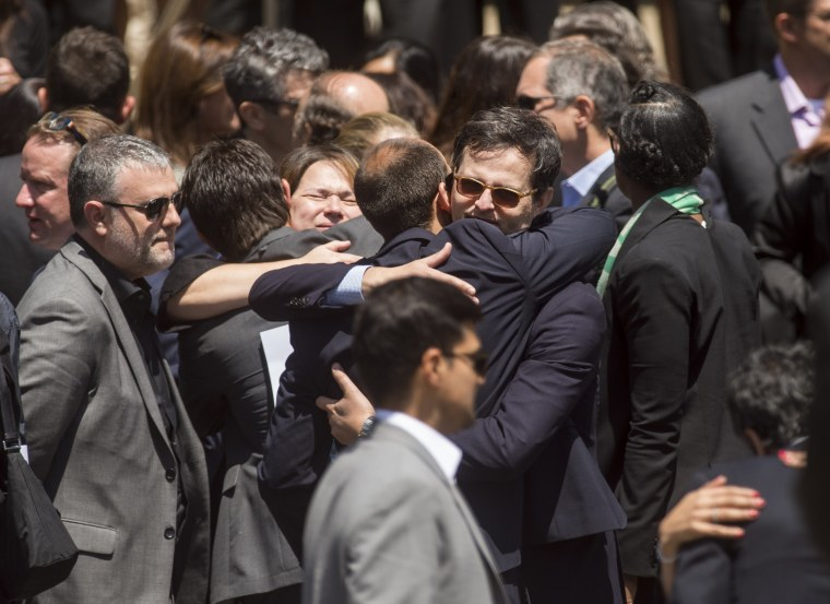 Mourners leave a memorial service for SurveyMonkey CEO David Goldberg on Tuesday, May 5, 2015, in Stanford, Calif.