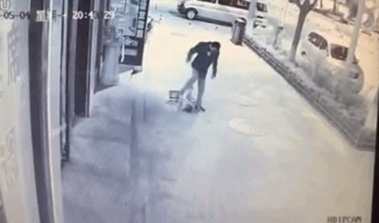 Image: a toddler being brutally beaten by a man
