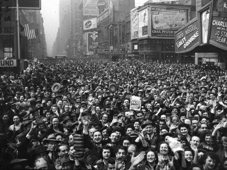 New Yorkers jam the streets of Times Square at 11 a.m. on May 7 to cheer the news that Germany had signed the documents of unconditional surrender
