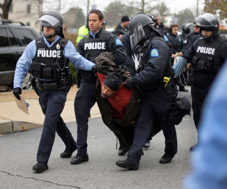 A protester is arrested outside of the St. Louis city hall Wednesday during riots over a grand jury's decision not to indict police officer Darren Wilson in the fatal shooting of Michael Brown, on Nov. 26, 2014.