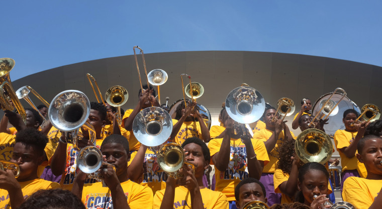 Image: The Edna Karr High School band performs at Champions Square.