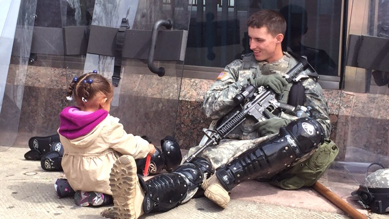 Young girl and a National Guardsman