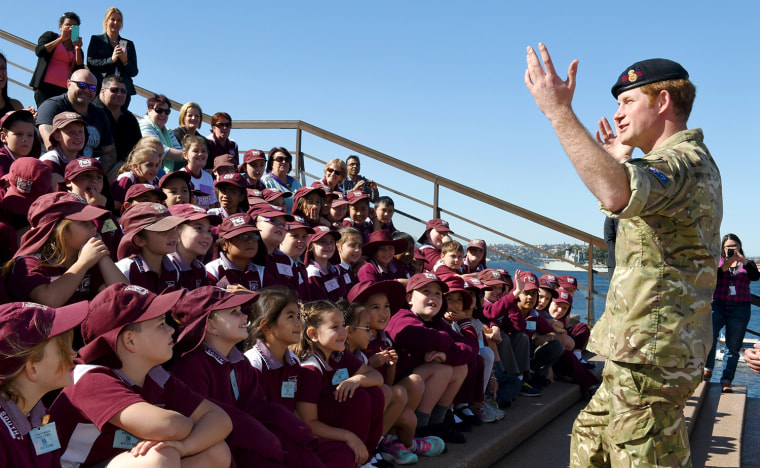 Britain's Prince Harry speaks to children from St Mary's South Public School during a visit to Sydney's Opera House