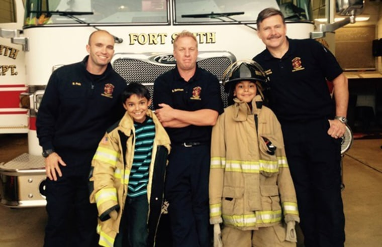 Timmy and his brother with firefighters