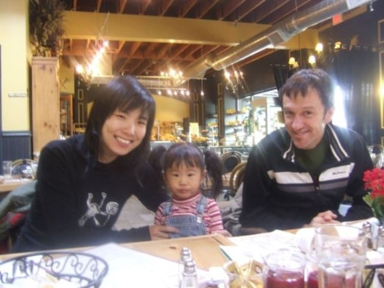 Sandra Kim, Willem van der Hoeven and their daughter Adriana. Sandra kept a super-detailed baby book for Adriana because she didn't want to forget a single moment.