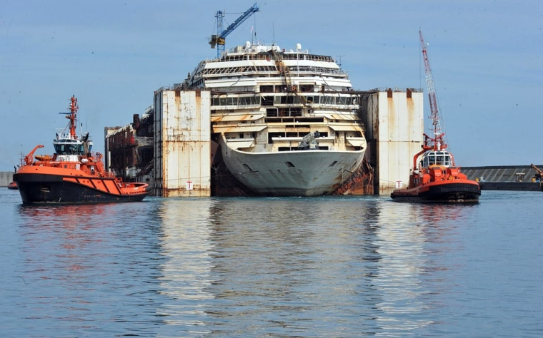 The shipwrecked Costa Concordia cruiser is pulled away by tugboats from the Genoa harbor, Italy, to be demolished, Monday, May 11, 2015.