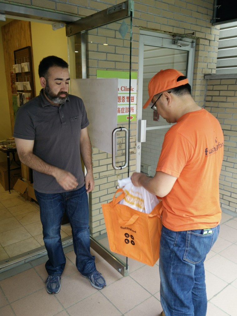 David Troise, who works on 37th Ave in downtown Flushing, receives desserts he ordered from flushingfood.com. Troise says he orders from the website once or twice a week.