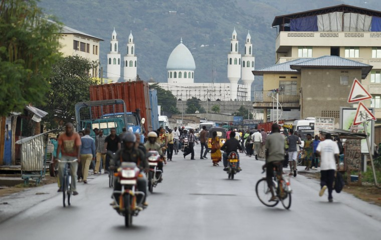 Image: ople travel along a street near the Al-Markaz mosque in the Nyakabiga neighbourhood of Bujumbura, Burundi