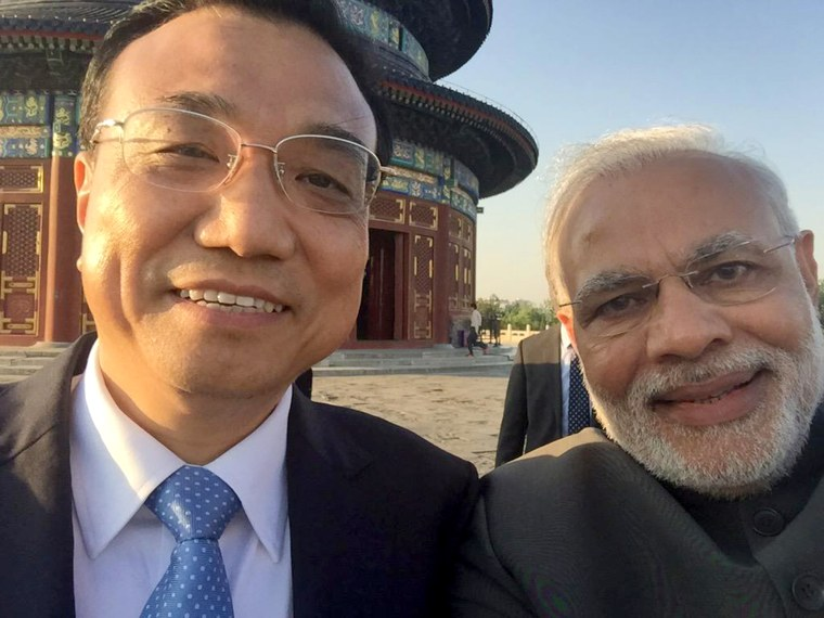 India Prime Minister Narendra Modi takes time out for a selfie with Chinese Premier Li Keqiang at Temple of Heaven Park in Beijing, May 15.