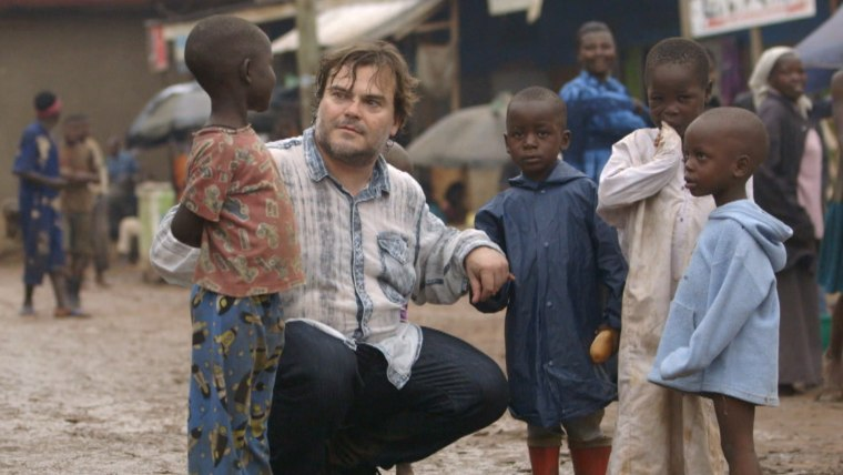 Jack Black speaks to children in a slum in Uganda to raise awareness of kids living in poverty as part of Red Nose Day