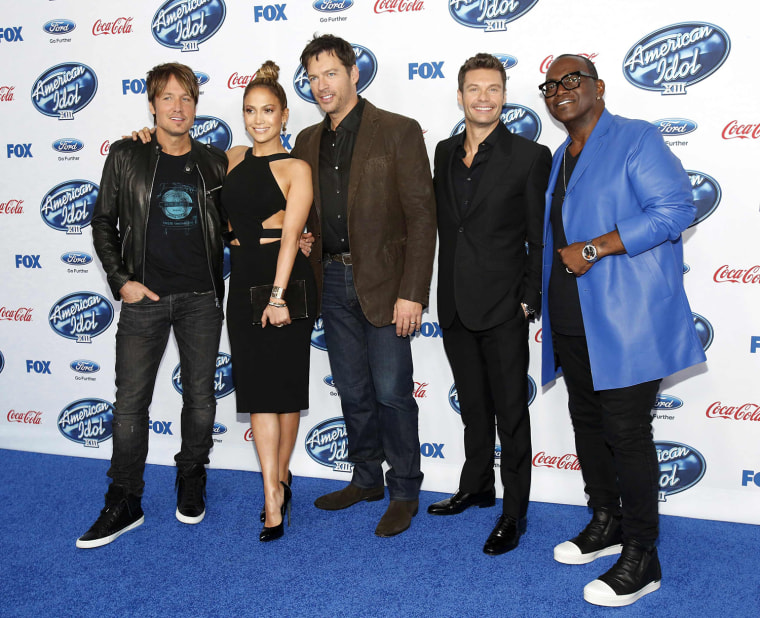 "Singers and judges Urban, Lopez and Connick, Jr. pose with host Seacrest and producer Jackson at the party for the finalists of ""American Idol XIII"" in West Hollywood"