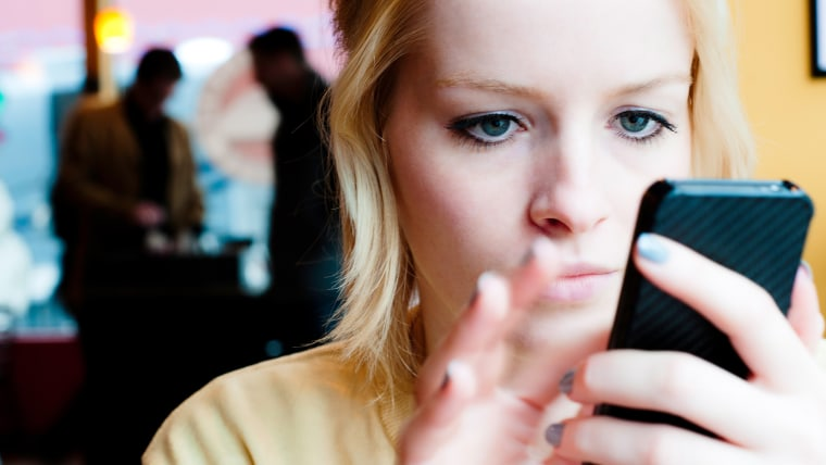 A young woman uses a smart phone