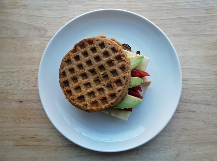 Waffle sandwich with turkey, pepper jack cheese, avocado and peppers