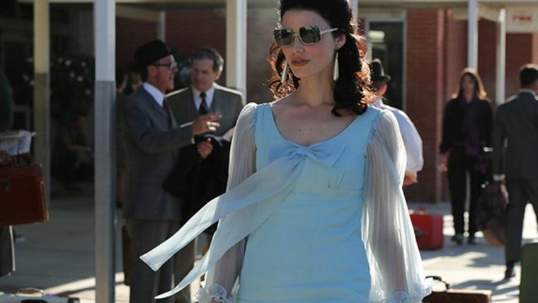 Jessica Pare as Megan Draper.