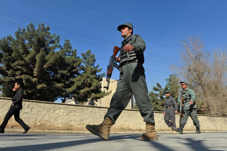 Afghan security forces are pictured near the main gate of the National Directorate of Security in Kabul in 2013.