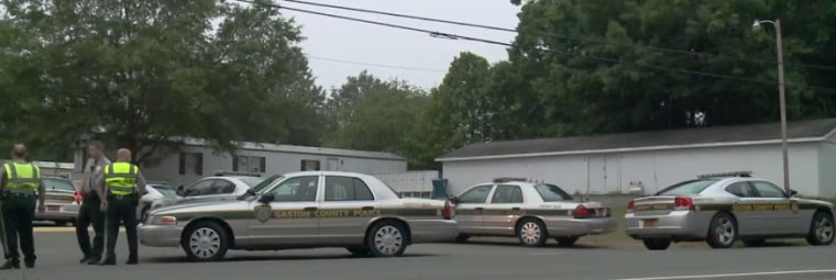 Image: Police vehicles outside the scene of a suspected murder-suicide in Gaston County, South Carolina