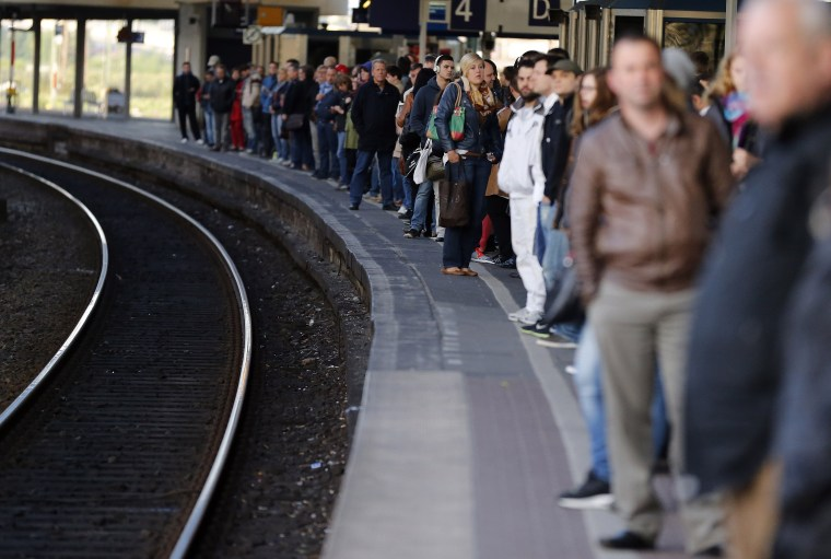 Image: Commuters wait for rare trains in Duisburg, Germany