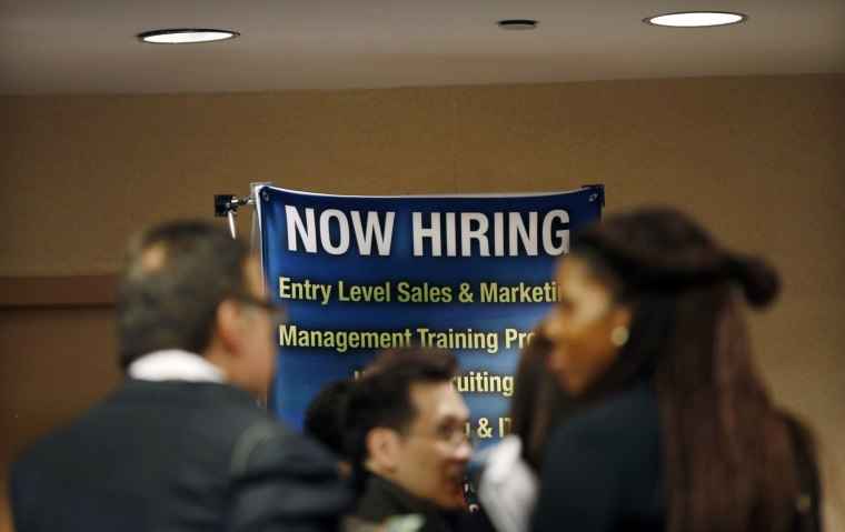 Image: Job seekers wait to meet with employers at a career fair in New York City