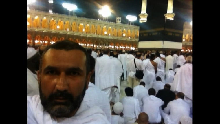 Sharma takes a selfie with his iPhone at the Kaaba, where filming is forbidden.