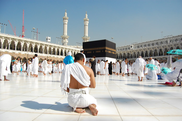 A pilgrim deep in prayer at the Kaaba.