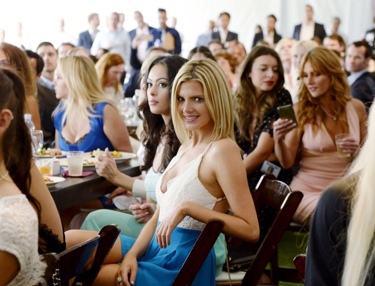 Image: Stephanie Branton, Miss September 2014, and Playboy playmates from over many decades attend 2015 Playboy Playmate of the Year ceremony during a luncheon on the garden grounds of the Playboy Mansion in Los Angeles