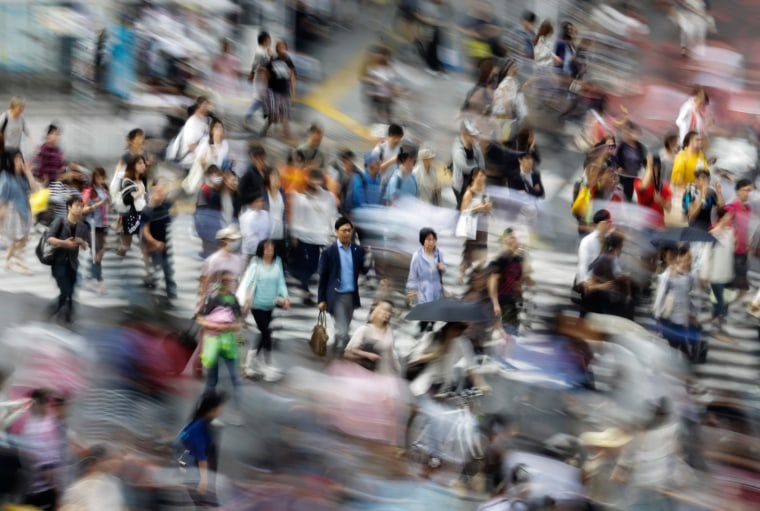 Image: Pedestrians on a crossway in Tokyo