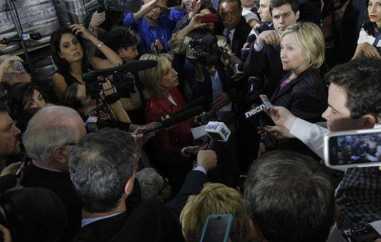 Image: Democratic presidential candidate Clinton talks to the media after a campaign appearance at Smuttynose Brewery in Hampton