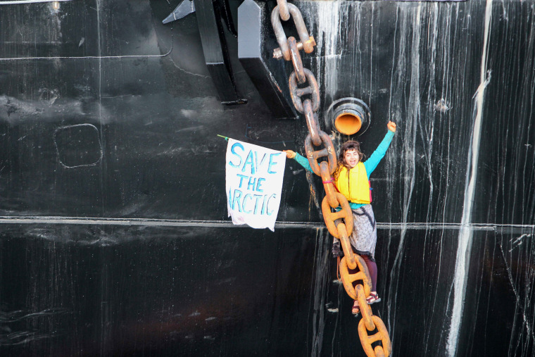 Image: Activist Chiara Rose suspended herself in a climbing harness onto the anchor chain