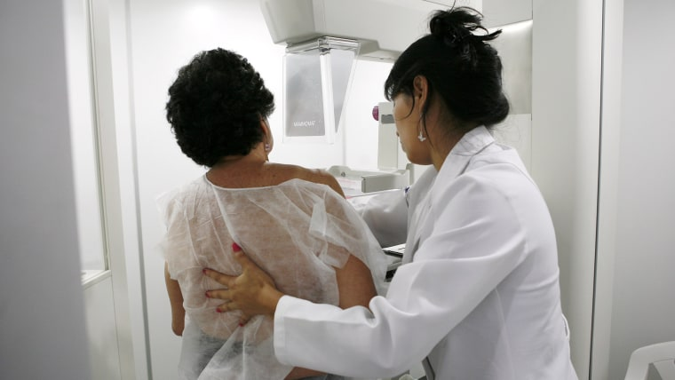 A woman undergoes a free mammogram