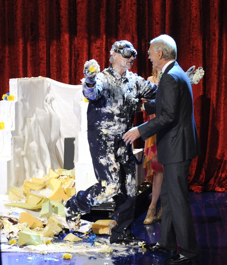 Bill Murray jumps out of giant cake, when he makes his final appearance on the Late Show with David Letterma