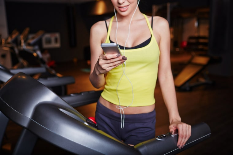 Woman on mobile phone while working out