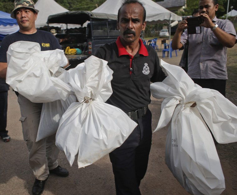 Image: Malaysia finds 139 graves of suspected trafficking victims