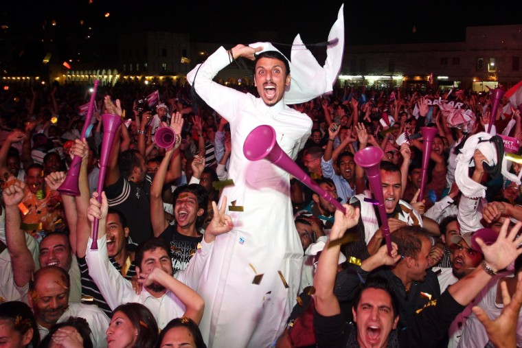 Image: Qatari fans celebrate after being awarded 2022 World Cup