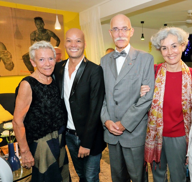 Sorel Thongvan (second from left) poses with Jean-Francois Cautain, Ambassador of the European Union to Cambodia (second from right), at the launch party for Thongvan's new magazine Q Cambodia, the country's first print magazine geared toward the lesbian, gay and transgender community.