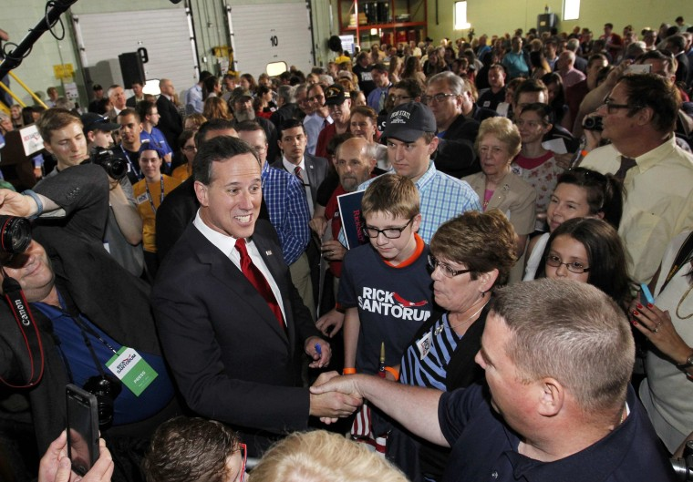 Image: Republican presidential candidate and former U.S. Senator Santorum greets supporters after announcing candidacy for the 2016 Republican presidential nomination during event in Cabot, Pennsylvania