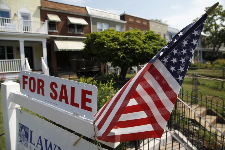 Image: For-sale sign at a home in the Capitol Hill neighborhood of Washington