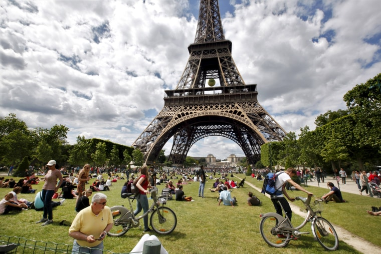 Image: Tourists near the Eiffel Tower in Paris on May 24