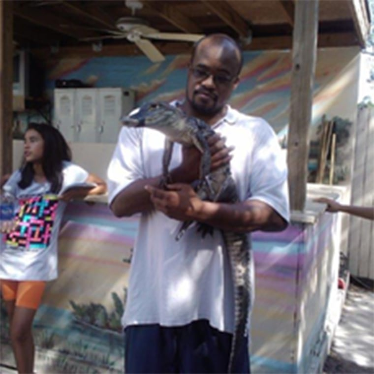 Image: Jermaine McBean with an alligator