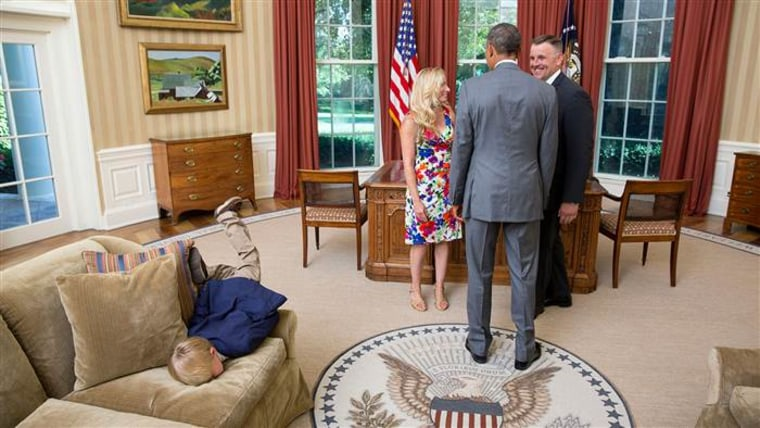 Kid face-plants in Oval Office
