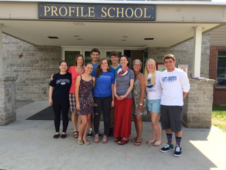 Courtney Vashaw, in red, shown with some of the members of the senior class of Profile Junior-Senior High School in Bethlehem, New Hampshire.  The class voted to skip their senior trip and donate their entire treasury of about $8,000 to help Vashaw fight a rare type of cancer.