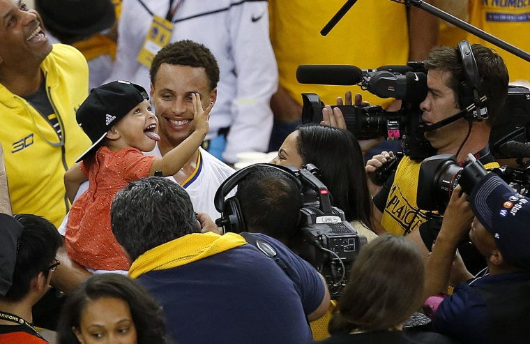 Stephen Curry and his daughter after the Golden State Warriors win
