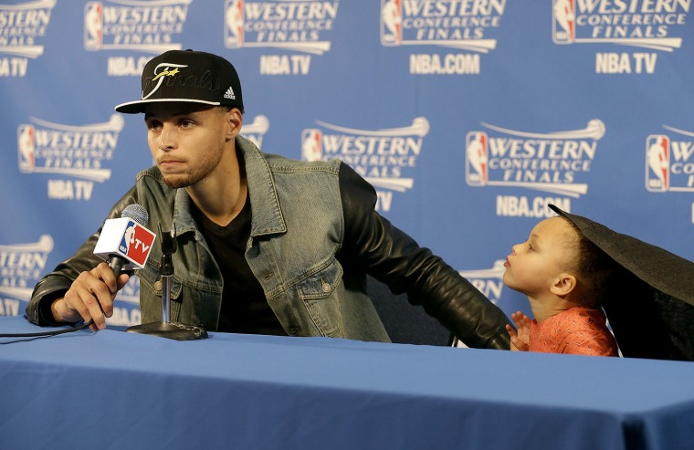 Stephen Curry and his daughter at the press conference following the Golden State Warriors win